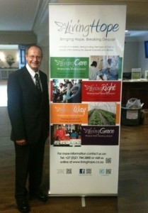 John Thomas with Living Hope Ministries Banner