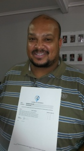 Nathan Panti displays the Statement of Achievements certificate with Services SETA approved results